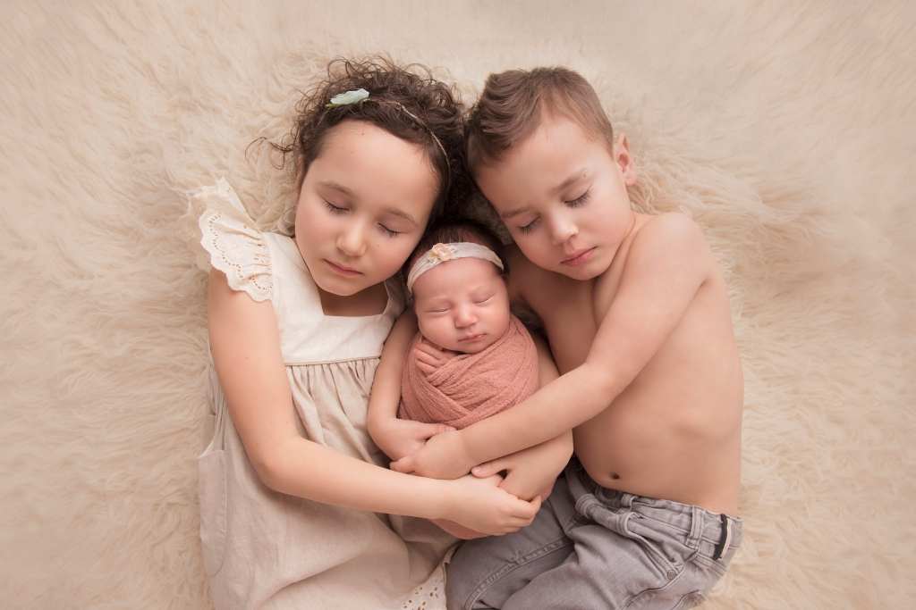 Siblings; newborn Photographer; Baby; expecting; family; professional; studio; posed; pregnancy; sister; brother;